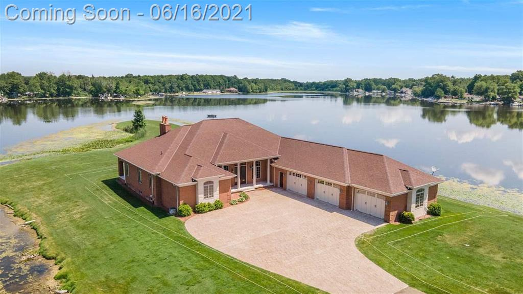 Two homes, 14 acres, two outbuildings, 5500 feet of WATERFRONT on Potter Lake Peninsula-all sports lake. The main home features over 3800 square feet with a stunning entry way, gorgeous gourmet kitchen, superbly designed octagon ceiling in the fire lit great room, phenomenal & spacious primary bedroom with a 23 x 18 walk in closet, fabulous main floor laundry room, PLUS exceptional views of the lake from every room! Your 57 x 26 attached garage and 2 outbuildings provide ample storage or a workshop.  The guest house features 1144 sq. ft, open floor plan, 2 bedrooms,  primary with a private bath & walk in closet,  2 half baths (one in the garage), sunroom and a 47 x 48 garage with a bar and garage doors tall enough for an RV or boat.  This unique opportunity is one of a kind: quality craftsmanship, outstanding architecture, golf course and lake views, wildlife on this one of a kind property, gated entrance. Five acre parcel being split from the parcel by the owner.