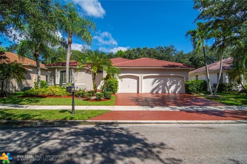 Triple Split Plan with Three Car Garage Home In The Islands of Weston Ready!Beautiful open plan perfect for all your entertaining. Enjoy the pool & beautiful, private, lush landscape to give you a feeling of tropical bliss. Exterior paint 2019, Hunter Douglas window treatments, Stainless steel appliances and hurricane accordions. Guest rooms are large enough for queen size beds & have walk-in closets. Third guest room is very private and separate from the others.Master Suite features his & hers closets PLUS sitting room/office/nursery or fitness room. You will love the size of this laundry room!Crown moldings, volume ceilings, immaculate! Walk to middle school, Town Center and places of worship. A+schools. Located in quiet, gated community w/ tot lot, sand volleyball, basketball for fun!