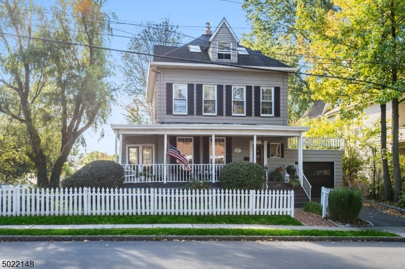 "A Large Old Fashioned Front Porch Welcomes You to this Charming 4 BR Colonial!Conveniently Located 1/2 Mile from Train to NYC & Downtown! Voted ""Best Downtown in NJ"" 2 Yrs in a Row! Lots of Old World Charm along w Modern Updates! Features incl HW flrs, Recessed Lighting, Beautiful French Doors that open into the LR and Den, Built in Shelving,Crown Moldings,High Ceilings. New HW Heater,Furnace & Elec Panel. Amazing Kitchen w Commercial Vulcan Stove/Oven along w 2 add'l ovens, 2 sinks, Stainless Appl & Center Island! Attic Space w 3 Skylights and exposed Brick can be Easily Transformed into a Unique Cozy Space!2 Decks off DR & Kitchen lead to a Private Backyard where you can Relax in a Gazebo covered Swing! Home Warranty Included."