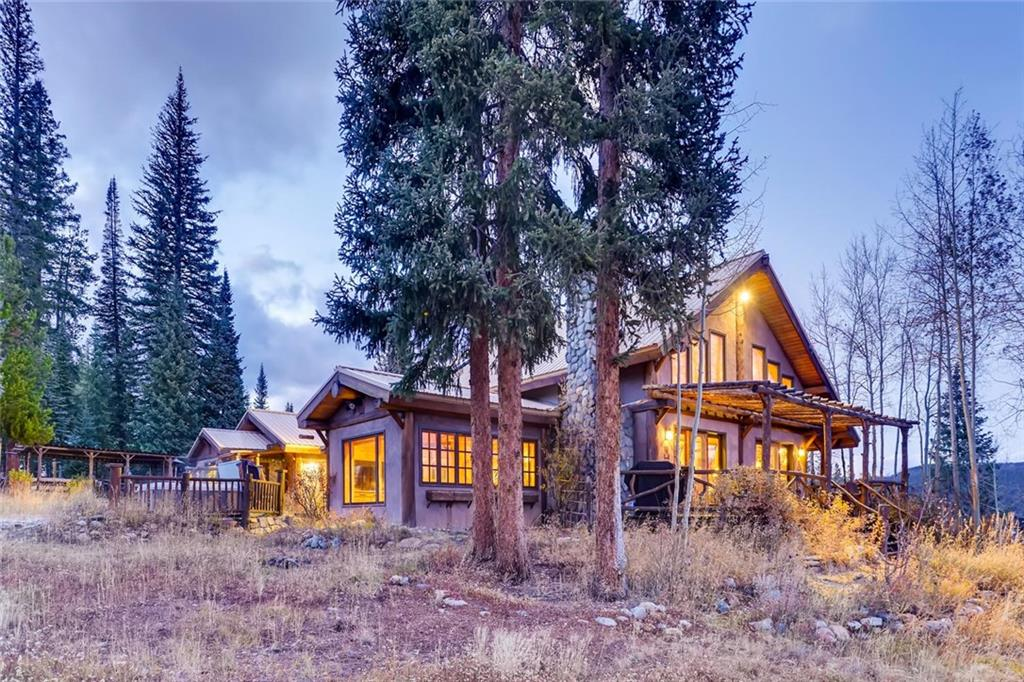 This Rustic Mountain Retreat is unlike anything you'll find in the Colorado Rockies. Huge 360º views make this home truly special. Close to everything Summit County has to offer, yet tucked away boarding National Forest for a quiet and tranquil feeling. Construction of the home & furniture were mostly from harvested timber on the property and provides a ton of character. This home features 3 living areas, office, two-car garage, large detached studio, storage sheds and incredible outdoor living.