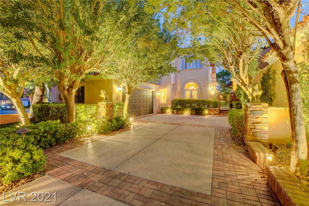 **A Spectacular Mediterraen Style home in Prestigious Guard Gated Canyon Gate Country Club!**Former Model Home of the Renowned Luxurious Opus Collection!**Surrounded by the manicured greens of the Golf Course, this elegantly fashioned fairway home awaits. Magnificent VIEWS of the Ted Robinson designed Golf course, Lake & Spring Mountain range. A quietly shaded backyard w/pool & spa, covered patio, barbecue, outdoor fireplace, & firepit creates the perfect location to relax & revitalize. Formal Entry Foyer w/massive vaulted ceilings, Formal Living Rm/Dinng Rm. Library Rm w/French Drs. Chefs Kitchen with Sub/Zero Refrigerator,  Walk-in Pantry & Breakfast Nook, Family rm, & Laundry rm located on 1st Floor. Beautiful Primary Suite w/sitting rm, 2-way Fireplace & Covered Balcony! Primary bath w/JetTub, Marble Shower, Custom Closet.  Crown Mouldings, Plantation Shutters, Hardwood Floors & More! Located nearby Tivoli Village, Boca Park, Downtown Summerlin, Redrock Canyon and more!