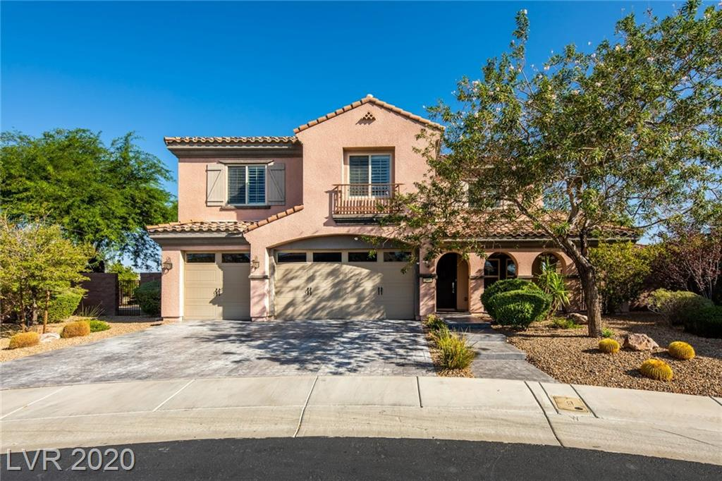 Remodeled home situated on a premium elevated lot in the guard gated community of The Club at Madeira Canyon. Kitchen and family area flow together creating the ideal space for relaxing or entertaining thanks to a built-in entertainment center. State of the art kitchen is complemented by quartz counters, modern cabinetry, and GE Monogram stainless steel appliances. Primary suite boasts covered balcony with strip and mountain views. Flexible spaces include a large casita and a loft with balcony. Sleek modern home was fully remodeled in 2015 featuring upgrades such as wood plank tile, hardwood, two tone paint, ceiling fans, contemporary fixtures, and modern stair rail. Convenience items include epoxy garage floor, intercom, central vacuum, Kinetico water treatment, tank-less water heater, and a new upstairs AC with nest thermostat. Elevated yard highlights views and is treated to a refreshing pool, relaxing spa, outdoor shower, pool bath, outdoor kitchen, and covered patio.