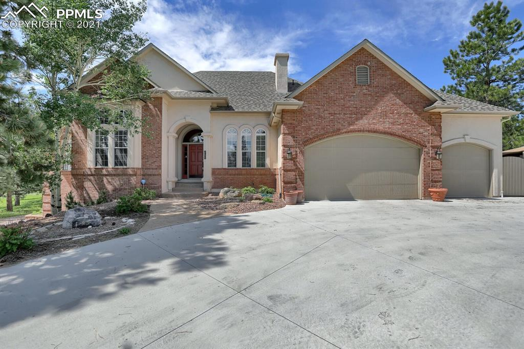 Don't miss this exceptional Kings Deer home in a golf course community.  Beautiful 2.5 acre treed lot with incredible outdoor living spaces, with numerous water features, amazing patio and deck.   Recently replaced wood floors and kitchen counter tops.  Spacious Family/Rec room with a large bar area for entertaining.  This house has everything you could want, close to Colorado Springs and easy access to I-25 and Denver.