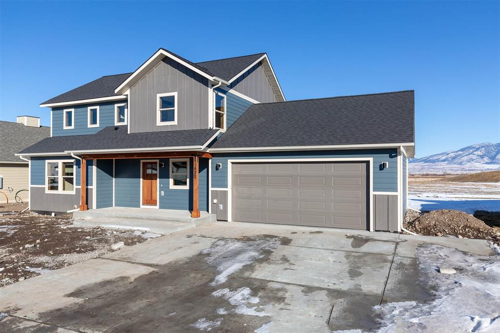 This newly constructed Home sits on a 11,000 square foot lot.  The Home does back to Park space with awesome views.  This Home has 4 Bedrooms, 2 1/2 Bath with a Main Floor Master. 2nd Floor has a flex room that is great area for a 2nd living room. The interior finishes will include Granite Counters, Gas Fireplace, Hardwoods Flooring, Tiled Bathrooms and a special touch to the trim work.  There is a large covered Porch with Southern exposure.  The covered Patio is a great spot for entertaining and enjoying the beautiful views of the Bridger Mountain Range. The Home is priced to include underground sprinklers and sod.