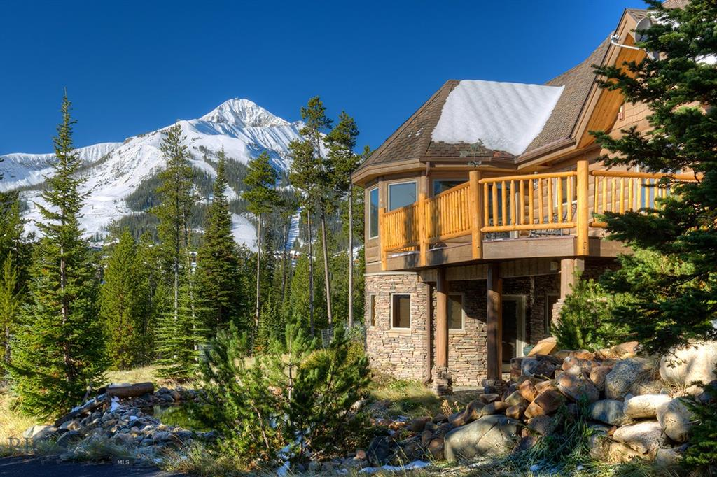 Spectacular Big Sky Ski-in/Ski-out custom Log home in Cascade subdivision. Enjoy direct unobstructed views of Lone Peak and Andesite Mountain from the spacious great room, gourmet kitchen, dining area and master bedroom, all on the Main Level. The walk-out Lower Level features a large den/family room with plenty of natural light, an outdoor Hot Tub, large wet-bar w full size refrigerator, 3 bedrooms, and 2 full Bathrooms. This meticulously maintained home sits on a large 1 acre corner lot, adjacent to the skiers access trail to Cascade & White Otter Lifts. In the summer you'll enjoy an acre of wooded property, and pond with cascading water feature. The Main Level large heated 2 car garage leads you into mudroom/Laundry; an Office or bonus room; a half-bath, to the Great Room and Master. This home is truly a gem, a classic Big Sky Log home built of kiln-dried Canadian logs, the panoramic Southern and Western exposure offer world-class views of Big Sky's slopes and the mountains beyond.