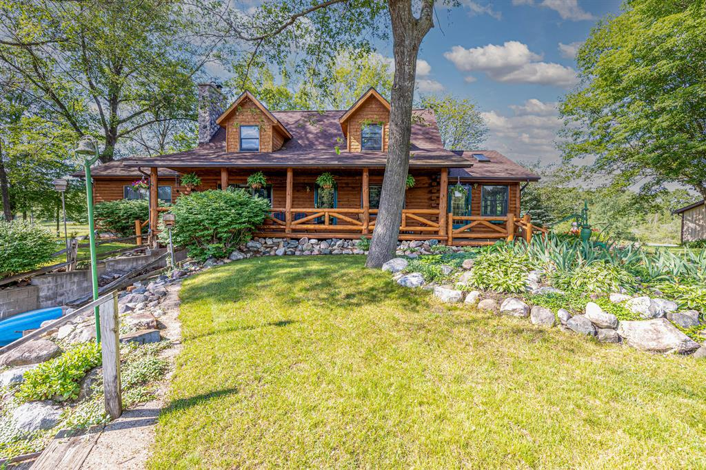 CUSTOM Log Home with 7+ Acres, private pond and over 560' of frontage on Lake of the Hills.  This is a one of a kind properties that seldom comes available.  Privacy, seclusion, immaculately maintained with water views all around.  If a picture is worth 1000 words then these photos are worth a MILLION  Lake of the HIlls is a no wake lake with excellent fishing and ideal for cruising and relaxing.  The private pond is well stocked and plenty deep.  Finished lower level with wine cellar, safe room and game room with wood stove. This is a ONE OF A KIND properties DONT miss out. LOOK TODAY.