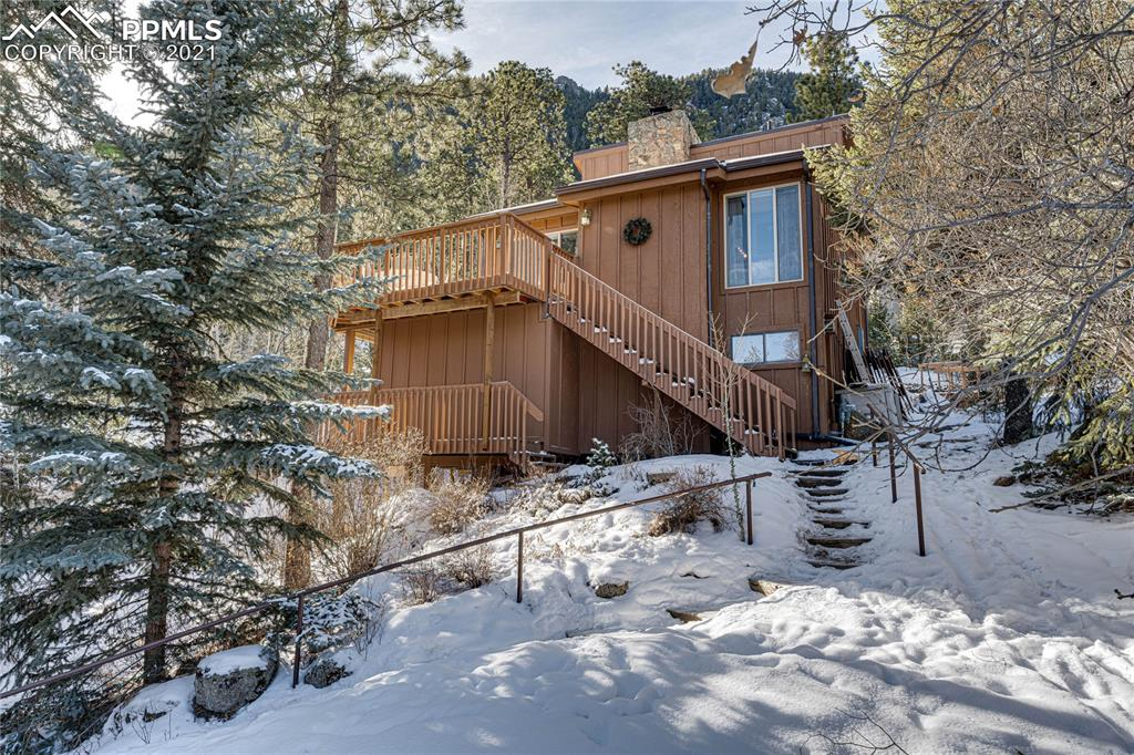 This beautiful home is in the very popular Green Mountain Falls area. The home sits in the woods where it's surrounded by mature pines that seem to stretch endlessly toward the sky. The house has a large deck where you'll enjoy the mountain views and the peaceful serenity that only the mountains can provide. If you feel like a hike, then the Catamount Trail is just a short walk from the back of the home. This mountain home is a perfect vacation home for anyone looking to get away from the hustle and bustle of the city. It can also be your own private mountain sanctuary year-round.   The home boasts cherry cabinets, granite countertops, and stainless steel appliances. This home is also great for a VRBO or an Air B&B. Don't let this one get away from you.