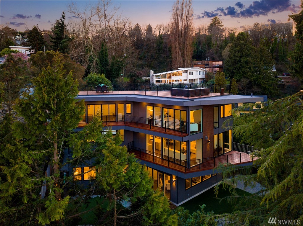The NEST designed by Lemons Architecture and built by premier luxury home builder Barcelo Homes. Urban Architecture masterpiece overlooking Portage Bay & UW, capturing breathtaking mountain & territorial views. Timeless, warm and inspiring finishes. Serene Master retreat with spa inspired bath, media room with access to private yard. Each bedroom complete with en-suite bath. 5516 total square feet, including over 1500 square feet of decking! Convenient to downtown, UW and South Lake Union.