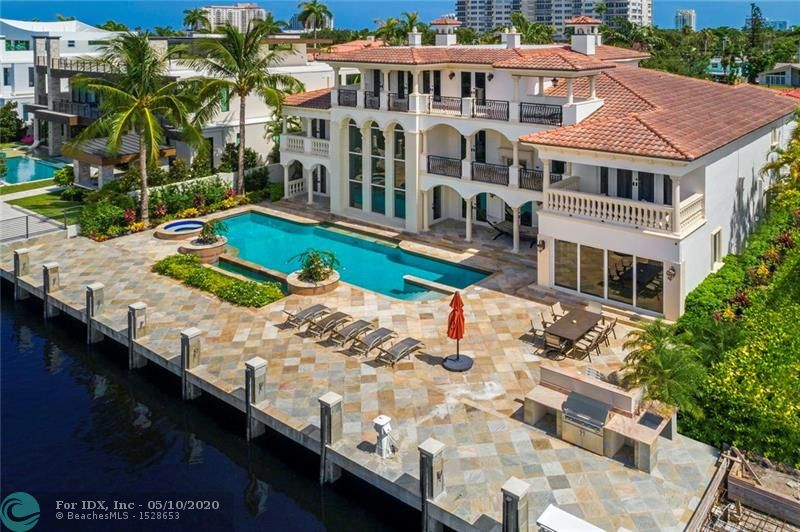 The most elegant waterfront estate in posh Las Olas neighborhood of 7 Isles. Large flowing floor plan, 8700 square feet, 6 bedrooms, 7 baths, wood paneled office, 2nd floor lounge, 3rd floor billiard, media room, bar. Custom built, impeccably cared for by original owners in like-new condition. New seawall and dock, 55' pool, lap lane, new pool surface. Pool deck is unique beautiful Brazilian quartz. High quality granite, marble, quartz installed by European craftsmen. Bar area connects chef's kitchen, formal dining room and two-story living room with gas fireplace. Master suite includes sitting, exercise room, two large closets, separate toilettes, dual sinks/vanities, onyx countertops, jacuzzi, separate shower. 24/7 security, walking distance to downtown,