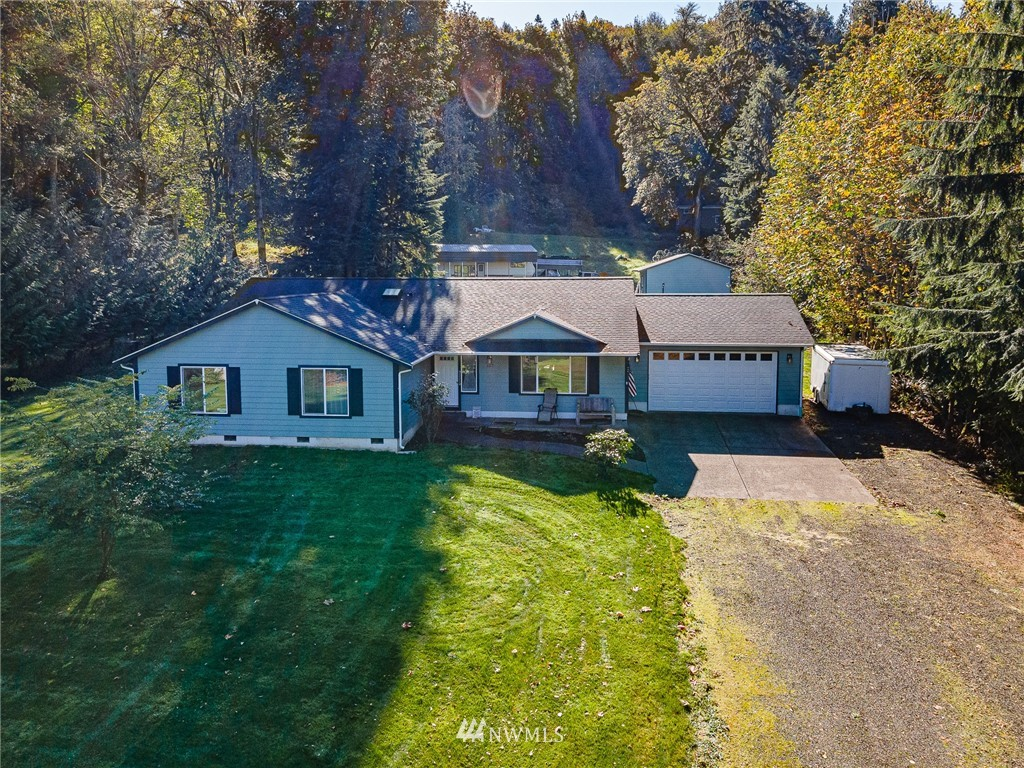 PRICE REDUCTION! Perfect location! Minutes to 3 public boat launches, 2 lakes & 1 river.2112 sq feet,4 bed, 2.5 bath one level home w/upgrades & open floor plan on 1.84 acres.Granite countertops w/hardwood floors & NEW carpet.Heat pump w/electric air filter, Central A/C!24x24 detached shop w/air compressor & pellet stove. 18x40 cover for your RV with full hookups. Addt'l  10x20 cover for boat, etc.All appliances included,+Honda generator. Leaf filter gutters.Gorgeous territorial & mountain views.Come view today!