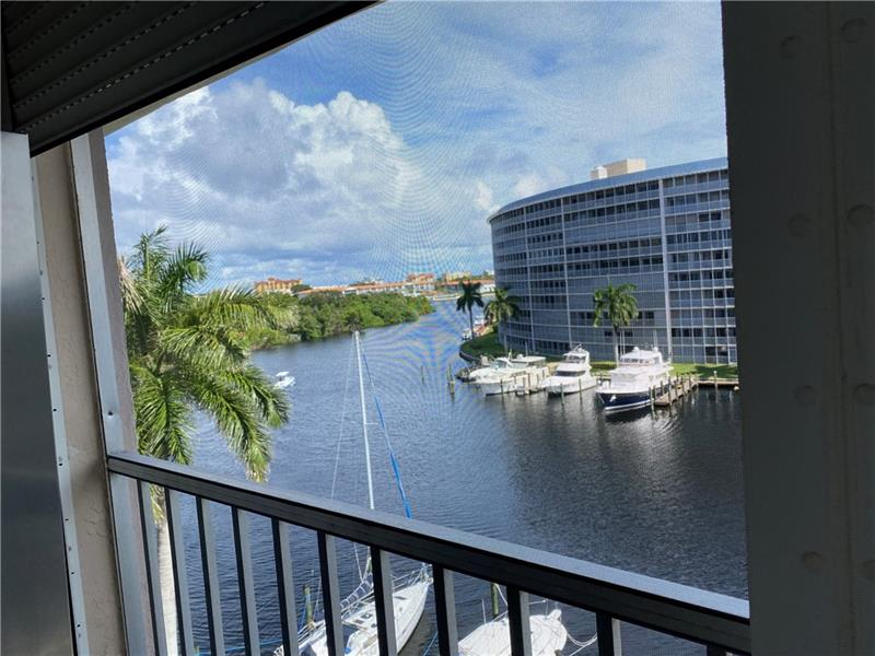 This top floor, 2/2 condo with Intracoastal Waterway views is ready for a new owner! Nearly fully furnished, with lots of remodeling and updating already done. The only furniture shopping you'll need to do is for a dining table and chairs. Are you a boat owner? Hillsboro Cove has a private marina where dockage is $2.75/foot/month. Walk to the beach, shopping, restaurants, medical care, and houses of worship. Lovely clubhouse and pool, just steps away! A spotless clean laundry facility is on the first floor, although residents are allowed to install them in their unit. Screened balcony has power hurricane shutters.  Enjoy the active 55+ lifestyle in paradise!
