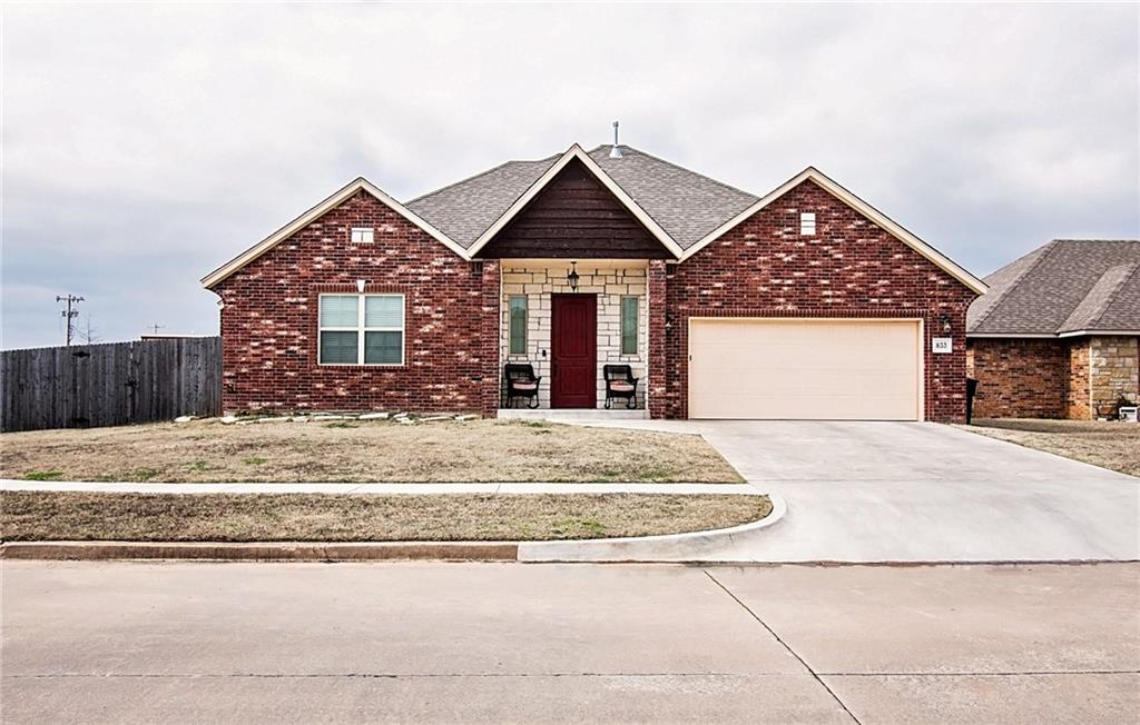 This is a beautiful home with an open floor plan, 3 bedrooms and 2.1 baths, with easy access to I-35. Knotty Alder stained wood work through the home, granite counter tops in the kitchen and both bathrooms! A great kitchen island for entertaining, with an abundant amount of counter top space. Beautiful wood like tile. An over sized farm door leading to the built in bookshelves and convenient hallway desk, jack and jill bathroom, and over sized closets throughout the home. Master bathroom features a jetted tub and a walk in shower! Master bedroom walk in closet conveniently connects to laundry / mud room. The perfect tandem garage for all of your toys. All of this and on top of it, there is no HOA for this neighborhood! DON'T MISS OUT ON THIS HOME, schedule your showing today!