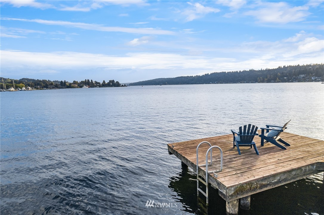 A truly unique, once in a lifetime opportunity to purchase this street-to-waterfront property located on the shores of Lake Washington. Take in rare and expansive south facing views from this nearly flat large lot with 133 feet of waterfront! Enjoy modern living in this Classic 4 bed/3 bath home or update, expand or rebuild.  Enjoy the large private dock and boat lift. Enatai Elementary & award winning Bellevue schools. Close to Old Main and downtown Bellevue shops and restaurants. Idyllic setting inspires year-round activities on the lake.