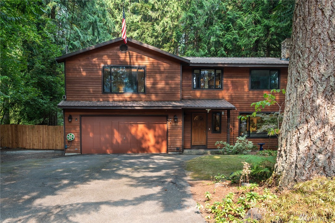 Enjoy your privacy on a larger park-like lot in Lake Marcel just one block from the community beach offering boating, swimming, picnics & fishing. This home has the feel of a lake retreat, complete with campfire pits under towering cedar trees. Home offers 2,570sf, office/den, wonderful master with walk-in closet, fantastic bonus room large enough for a MIL, new flooring throughout, covered rear deck, stone patio. Office can be 4th bedroom. New generator ready! Easy commute! SELLER PREINSPECTED!