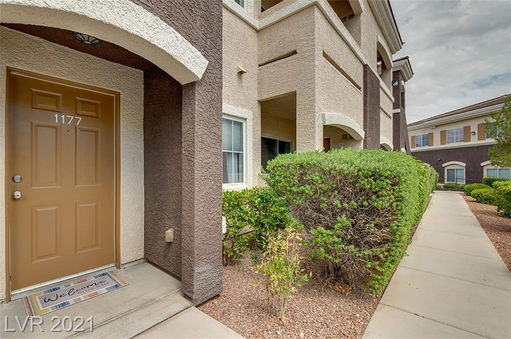 Check out this well- maintained, RARE find, FIRST FLOOR condo with detached garage in a gated community with a pool in the highly sought after Northwest (Centennial Hills/ Skye Canyon) area.  Condo comes with 3 spacious bedrooms and 2 baths.  Primary bedroom with private balcony Walk in Closet, nice-sized bathroom with dual sinks and walk in shower.  Comes with all appliances including washer, dryer, refrigerator. Beautifully maintained gated community with  a pool, a park and close to shopping and dining.  HOA pays water, sewer, trash.  Come see this property today.  IT WON'T LAST LONG!!!