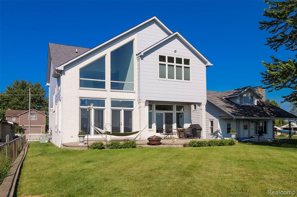 Awesome lakefront location just north of the Clinton River on Belvidere Bay! Contemporary colonial w/amazing views throughout! 2 story formal foyer w/hardwood flooring that continues throughout 1st flr! Great rm w/towering cathedral ceiling, decorative wood beams, gas fireplace, 2 sets of atrium doors & of course 2 walls of windows offering stunning views & tons of natural light! Huge kitchen & nook w/maple cabs, solid surface tops, built in appliances, walk in pantry & a sliding glass dr to the covered paver patio! Formal dining rm, 1st floor powder rm & lrg 1st floor laundry w/appliances! Massive rec room over the garage, thats also accessible from the garage, has so many potential uses; home gym, golf simulator, home office/biz, guest room, play rm for the kids, xtra storage, endless possibilities! Huge garage w/work area & 2 storage closets! Built high & dry, no flood insurance required due to elevation, sump in crawl never comes on, even w/the high water levels, high seawall too!