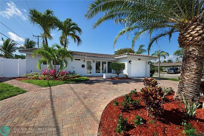 Everything in this 2 bed, 2 bath pool home is new.  Remodeled in a modern style with every part of the house updated less then a year ago.   Beautiful new kitchen with solid wood cabinetry and quartz counter tops.  New porcelain tile flooring through out every room in the home.  Both bathrooms have new flooring, tile, showers and vanities.  Brand new AC, electrical panel, wiring, and all NEW PLUMBING DRAIN PIPES.  All new hurricane impact doors, garage door and windows with plantation shutters on every door and window.  Outside there is new roof in 2018, new finishes on the pool, new paver driveway, new fence, and tropical landscaping through out front and back yard was just completed. This is a home that truly needs nothing to move in.