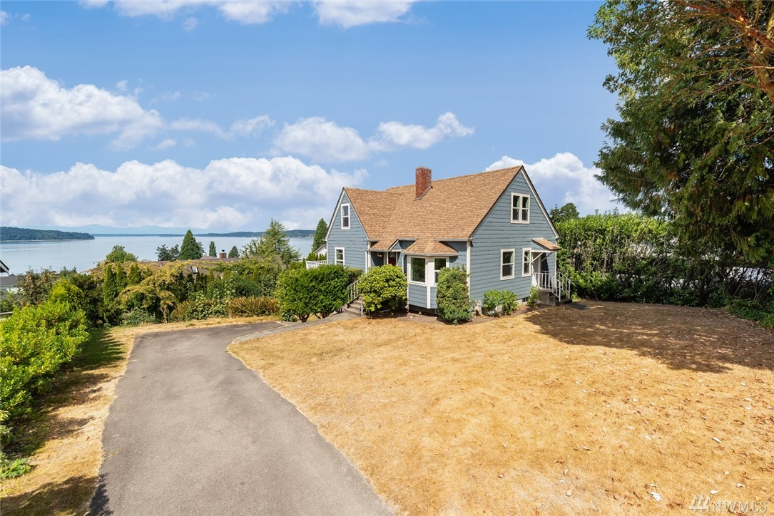 Daydream no longer! Breathtaking panoramic views of the Puget Sound & Olympic Mountains can be yours. Enjoy morning sunrises & nightly sunsets from the heart of Historic Steilacoom, steps away from the ferry & downtown. This 3 bed 1.75 bath charmer is flooded w/natural light & features an eat-in kitchen, master ensuite & an expansive deck for entertaining! Updates include a newer roof, newer Hardiplank siding & windows, fresh exterior paint, newer furnace & hot water heater! Only mins to JBLM.