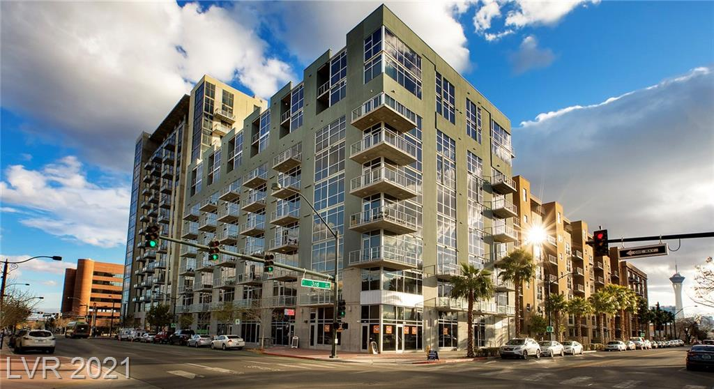 Up to 1 year seller paid HOA fees during May. Exclusions apply, subject to lender approval. Lrg opn flr pln loft style 1BD/2BA w/ den. Lrg kitc w/ tile, granite, SS apps, brkfst bar and backsplash, open to great room w/ balcony. Lrg BA w/ walkin. Juhl amenities inspire engagement, cocktails on the Vino Deck, unwinding poolside, a film in the alfresco movie theater. Steps to the Art District, Smith Cntr, LV Academy of Arts and more. Grd lvl shops & eateries, short walk to nightlife, public transport.