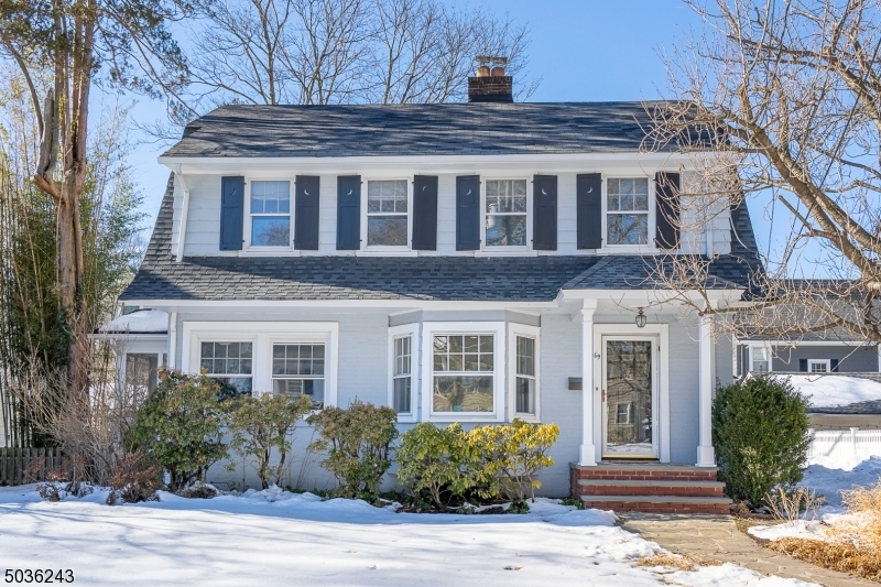 This special side hall Colonial, located in one of town's most sought after locations, will win your heart from the street! Comfortable, everyday living is  enhanced by the light that pours into each room complemented w/ easy interior flow. Sweeping Living Rm w/ WBFP & windows surround opens to Dining Rm w/ French door leading to 3 season side porch; updated Eat in Kitchen w/ white cabinets, quartz counters, built-in sideboard & china cabinet; Den & full bath complete the 1st FL. Bedrooms on 2nd level include master BR w/ cedar closet; 2 more large BRs, one w/ private half-bath; full hall bath. 3rd Fl is where you will find an open loft office & 4th BR. Lower Level industrial style office, laundry, workshop & storage. HW floors; 2-car detached garage; fully fenced rear yard; 1/2 mile to town & NYC trains.