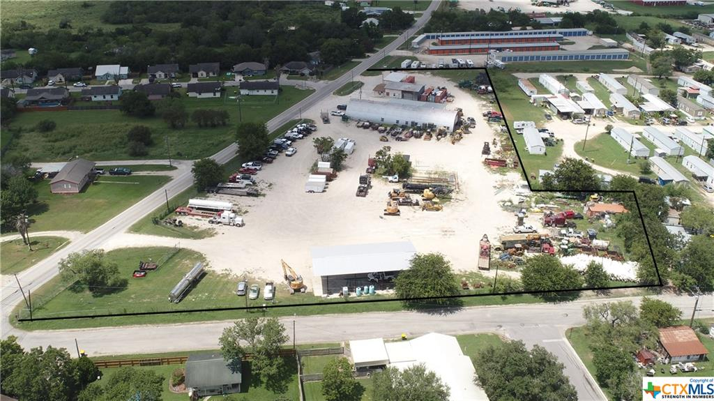 PRIME Commercial Property For Sale! 3.66 Acres. Zoned Heavy Commercial / Industrial.  AC Office and bathrooms fully insulated. This property is ideal for a tractor dealership or equipment rental business, or oil field truck parking and laydown yard. The main office offers an open area for a few desks for office staff and has a file room. Off the main office is  a private office and includes  a half bath.  At the back of the building offers a master office or living quarters with a kitchen and full bath. The big mechanic shop offers to offices and rest room. At corner lot end of the property is a semi truck wash bay.