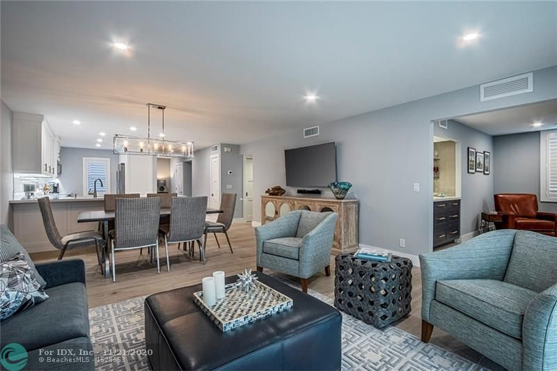 Designer touches abound in this fully renovated, move in ready unit.  Quartz countertops, custom cabinetry, stainless appliances, impact windows, electric blinds, new electric, plumbing and lighting are just a few of the features.  This unit is a highly sought after and rarely available corner property with canal and intracoastal views.  Relax on your private screened patio overlooking the water or enjoy the direct intracoastal pool, BBQ and Community Room with friends. Deep water dockage for your boat is available through the Association.  Third bedroom is currently a media room/bar area and can easily be converted back to a bedroom. Maintenance includes TV & Internet and full reserves.  Community is tree lined and immaculately maintained.  Welcome home!