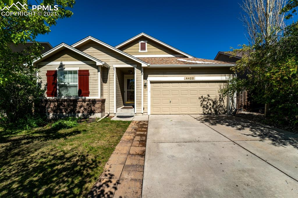 Beautiful well kept open layout with plantation blinds. Walking distance to Springs Ranch Elementary and Parks. Major shopping 5 min. Enjoy Pikes Peak view. Composite deck with stairway to cement patio  on ground level. Active Raspberry bushes growing in garden bed. Family room is being used as 5th bedroom for mother in law arrangements but it can be easily converted back to family room.  Must see!