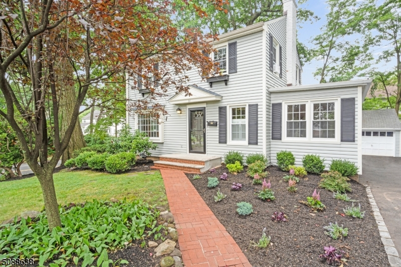 Spacious 4 bedroom 2 bath colonial on cul de sac well located close to downtown Fanwood,NYC train, and right across from La Grande Park.  The generous first floor has a formal living room and dining room with beautiful inlaid floors, large kitchen, family room, full bath and bedroom.  The second story has three bedrooms and a full bath.  Full finished basement.  Backyard is fully fenced with newer trex deck. New roof 2020.