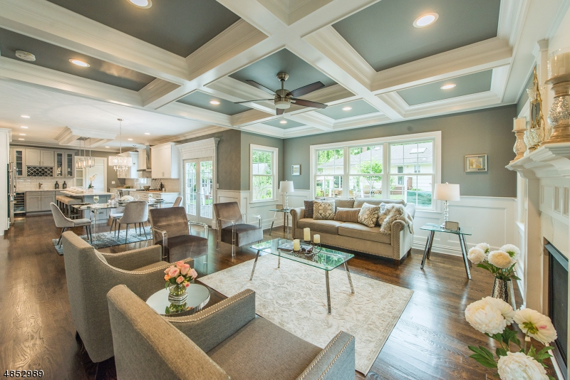 BEST V-A-L-U-E in SCOTCH PLAINS! Nestled on a quiet residential blocked on over 4,000 sq ft of pure luxury, this 2018 custom built colonial is loaded w/ modern day decor & designer inspired features throughout all levels. Dramatic 2 story foyer greets you as you first step inside followed by a fantastic open floor plan where warm wood floors lead you from one spacious room to the next. Gourmet Chef's kitchen opens to spacious FR feat a gas fireplace & coffered ceiling; SPACIOUS LR & formal DR along w/ a bonus bedroom w/ full bath complete 1st floor. The king size master suite feat soaring ceilings, his/hers walk-in closet & a spa like bath. (Interior photos are of a home with a similar layout built by the same builder)