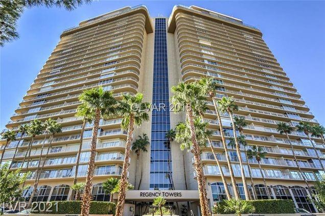 """Regency Towers Triple guard gated community centrally located at the Las Vegas Country Club.  This """"E"""" unit on a floor height desired by many has Views to the West including the LV STRIP, POOL, GOLF & MOUNTAINS! Truly a one of a kind unit..no other like it! Convertible office/bedroom and This unit has 2 3/4 baths and 1/2 bath. Floor to ceiling glass- NEWER WINDOWS/SLIDERS/TINT, tile floors throughout, granite counters, crown molding and a HUGE primary closet! The building features pool, spa, valet, fitness facility and guests suites. HOA includes water, sewer, trash, cable & internet. Unit has been freshly painted and is move-in ready!"""