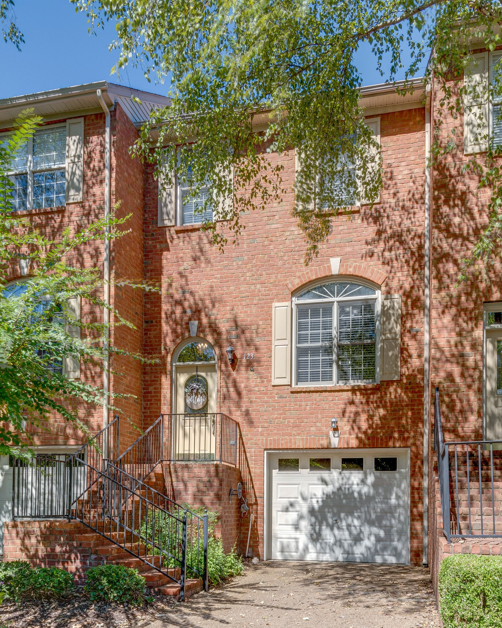 Beautiful Brentwood townhome! Amazing location- Less than 1.5 miles to 65, Target/shops/restaurants & convenient to Downtown Nashville & Franklin! Upgrades throughout include: flooring on main level, granite kitchen countertops, bathroom udates & more.  2 outdoor living spaces (patio and deck) that overlook the trees and feel very private/peaceful. One car garage is very oversized and has room for plenty of storage.  Double sided fireplace in living area/kitchen. Move-in Ready!