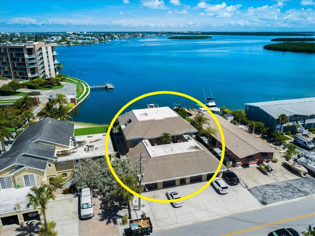 """Tucked away on the Isle of Capri community in Treasure Island, this waterfront, ground floor condo with deeded dock space is an absolute must see! The """"Capri Lighthouse"""" is a small, four unit pet-friendly building (2 pets with a combined weight of 100lbs) located on Boca Ciega Bay with easy access to the Gulf of Mexico through John's Pass. As you enter the unit, you'll be greeted by an abundance of natural light and taken by the water views that immediately meet you at the door. The kitchen is amply sized and features granite countertops, plenty of cabinetry for storage, and a nicely sized pantry. You'll never feel far from the action with the water views remaining visible through the pass through on the kitchen bar. The great room boasts ample space for both the living and dining areas with a nice alcove for a reading or office area. The covered patio overlooks the water and dock, making this the perfect place for that morning cup of coffee or evening cocktail. The rear of the property is also fully fenced. The spacious owners retreat is truly fit for both king and queen with a bonus area along with water views and a private ensuite with a large shower. The guest bedroom is also nicely sized with the hall bathroom with a shower/tub combo located just steps away. The indoor laundry room is located just off the front entry and completes this wonderful floorplan. The unit also comes with a detached one car garage for extra storage and parking.  Isle of Capri is situated minutes from some of the best beaches on the Gulf with many shopping and dining options just minutes away. Easy access to downtown St. Petersburg and its world class attractions as well. Property may be rented with a 30 day minimum not more than three times per year. Put it all together and you'll find this is one opportunity you don't want to miss!"""