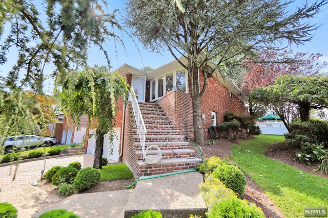 Come fall in love with this FIRST time on the market  ALL Brick home, built in 1968 on the southern part of Fort Lee (corner of Deerwood Rd. and Kingsland Lane) within one block to Inwood Terrace Park and only 20 min to mid-town Manhattan. Perfect Location.This beautifully landscaped two level home has fantastic natural light beaming in from the large windows and hard wood floors throughout. The home offers 3 Bedrooms, 2and half  Baths, Large Formal Living Room and Dining room. The downstairs open concept living quoters are great for extended family Large Family room with a wood burning fire place, Dining Room, Full Bath as well as updated Kitchen with private separate entrance.Enjoy the large  back yard with a nice size patio for your summer entertaining or just relaxing under the shaded tree. Amazing sunset views from the upper level! Two floors, use as an Extended Family home, 1st level above ground. Quiet and Private suburban home, 5 minutes to George Washington Bridge.