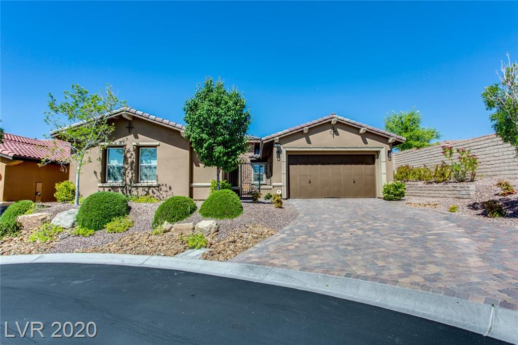 Great open floorplan w CASITA! Courtyard entry opens to dramatic foyer w/10' ceilings. Highly upgraded w tile thru-out. Gorgeous Kitchen w custom cabs, bkfst bar, granite cntrs & SS applncs incl dbl ovens & gas cooktop, tile backsplash & walk-in pantry. FR has cozy FP & BI shelves w open Den off Foyer. Large Master w sep tub/shower, dual vanities & walk-in custom closet. Stunning backyard w cov patio, synth grass, fountain & tiered landscaping.