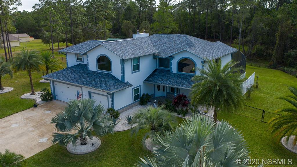 AMAZING 5 ACRE ESTATE W POOL! This gorgeous 3/3 2 story home sits on 5 acres (2-2.5 deeded separately) just 15 minutes from downtown New Smyrna Bch or Port Orange! The 1st floor bonus room could be used as an extra bedroom just add an armoire! It boasts high ceilings, new upgraded double pane windows, saltwater sparking pool, open floor plan with updated kitchen w granite countertops, new roof with skylights, new paint interior and exterior, new flooring, LED lighting throughout, new well and 85 ga tank, new water softener, new salt generator and heater for pool, new barn, new fencing, 3 car garage, in fact so many new and upgraded features we can't list them all! You need to take a tour and see for yourself! Bring your horses, goats or other animals! CALL TODAY AND SCHEDULE YOUR PRIVATE TOUR!!