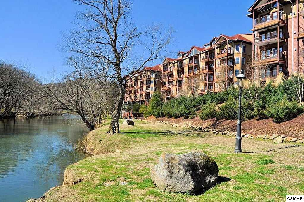 Wow the Views from this unit are breathtaking !!! This unit has been used as a second home and is in outstanding condition. This has a balcony off the back that looks directly at Mt. Leconte and the River. This unit is beautiful and has all the comforts of home and more. 2brm 2bath with a open floor plan. Right next to the Gym and walking distance to the pool. Enjoy the rippling sounds of the river. This comes furnished with the main furniture. ( All Personal Items and Keepsakes will not convey ) The condo has only been used as a permenant home and there is no rental income (easy to show). If buyers intend to rent the condo on the overnight rental progam, they are supposed to use the on-site management. As with all real estate transactions Buyers should do their own due diligence and verify all information independently, including possible HOA info. Purchase title insurance, get a survey, and any other inspections available. Most information has been taken from tax records and/or appraisal and not verified by listing agent/company.