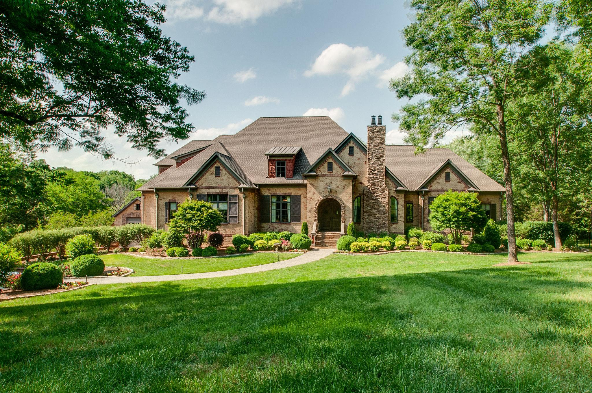 Unique and Rare Opportunity to own this French Country Inspired Estate.  Private setting near Warner Parks/ Ensworth. Williamson County Taxes.  RV garage (29X49) + 5 car garage.  4 bedrooms on the main level, in-law suite on lower level with 2nd kitchen.  Endless possibilities.  NO HOA.  OVER 100 Photos to View.