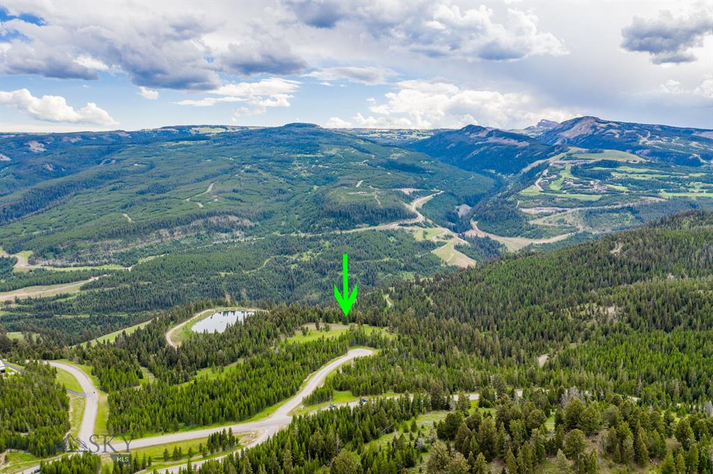 Gorgeous relatively flat property with old growth trees and wildflower meadows viewing south into the Yellowstone Club golf course and Pioneer Mountain.  End of the cul de sac location on Seclusion Point road.