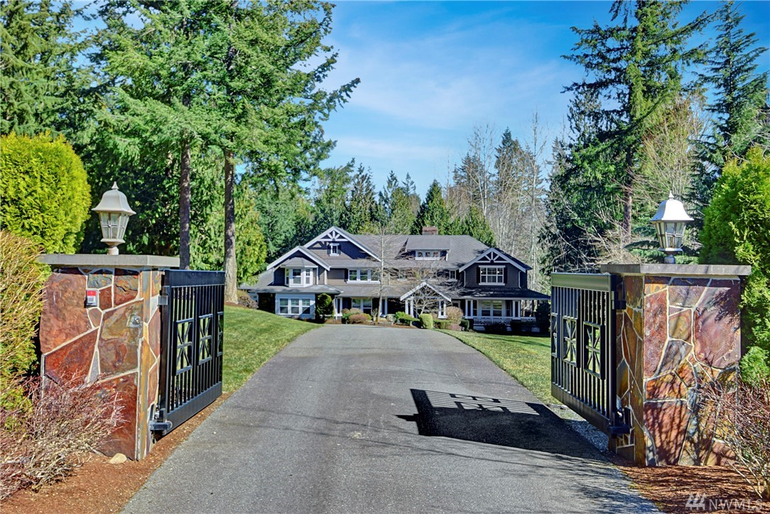 Truly custom luxury House on sitting on 2.4 beautiful private acres. 2 story stone fireplace. Natural stone and professionally done finishes throughout. Main floor guest suite, separate entry office, large master upstairs. Lower level game rm, wet-bar theater rm, & lots of storage spaces. Gated entry, circular drive with waterscape, outdoor dining, covered decks, sport court, designed fire pit & water sculpture. 4 covered parking spaces. You wont find another home like this one don't miss it!