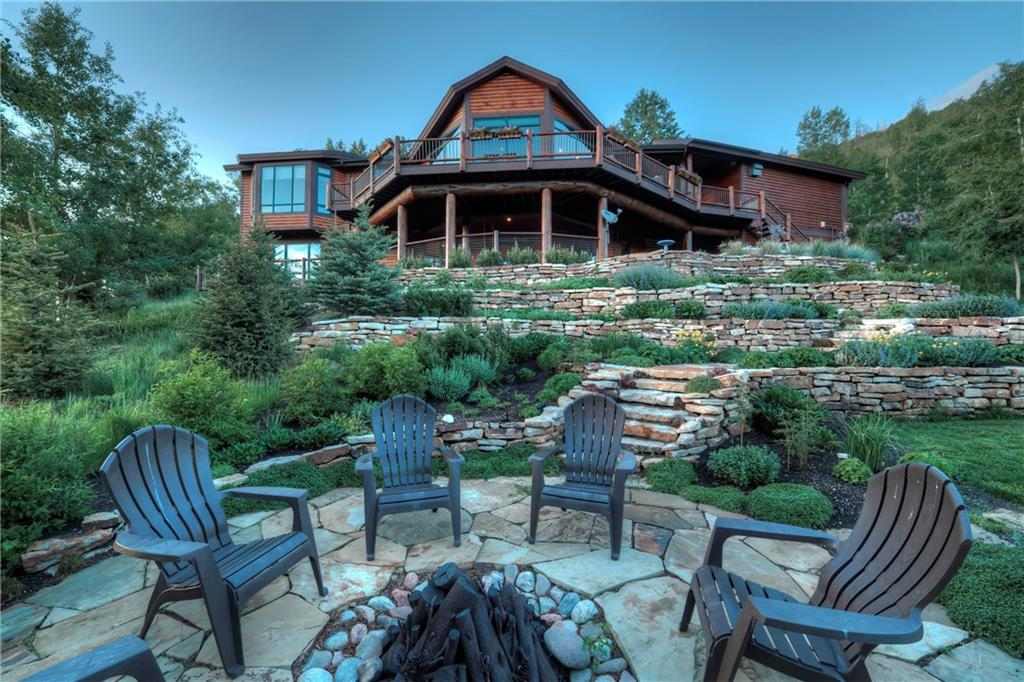 An amazing wall of windows offers Gore Range, ski area, lake and Ten Mile Range views. Perched within an aspen grove, this luxury home at the top of Hamilton Creek offers privacy yet easy access to all that Summit County has to offer. Main floor master, gourmet kitchen and an incredible floor plan make it perfect for entertaining.  Seller is replacing stairway carpeting and having the deck re-stained, so this home will be ready for its new family.