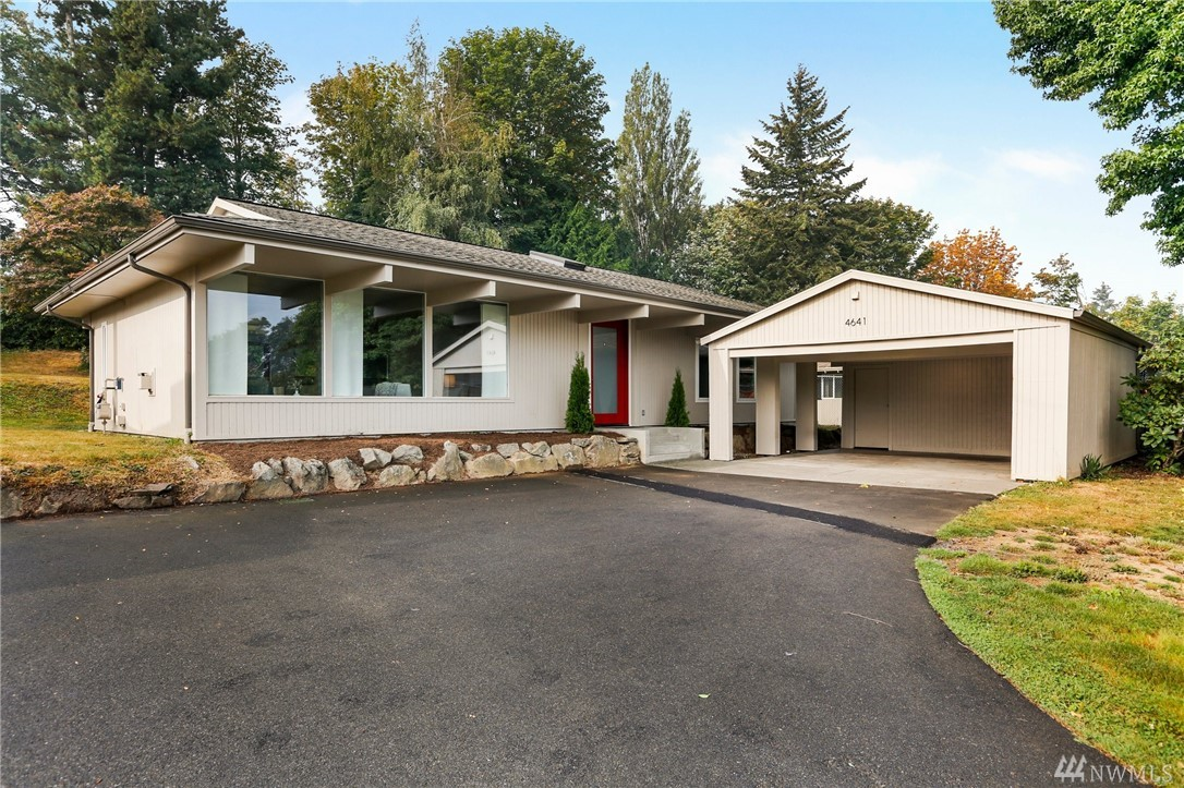Gorgeous mid-century modern, single level custom designed Horizon View home! Located on a large sunny grass lot, the home is move in ready & has been completely updated to reflect stylish living. Highlights include beautiful polished concrete floors,large windows,6 burner gas stove,natural gas fireplace & freshly painted interior. Unique location provides direct access to Horizon View Park in desirable,lush Lake Forest Park.2 car carport & generous driveway. Rare opportunity, this is a must see.