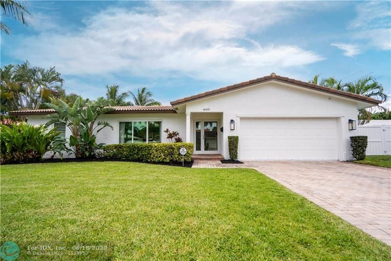 One of Lighthouse Point's best designed homes. Coastal inspired with attention to every detail. This 3 bedroom / 2 bath pool-home is fully renovated and perfect for someone who wants something move-in ready in a prestigious neighborhood on a quiet street. Open concept architectural design with two large living areas and a split bedroom floor plan with pool views from almost anywhere in the home. Other features include: impact windows and doors, travertine pool deck with new Diamond Brite Pool finish, cabana bath, lush private landscaping with huge fenced in grass area, newer AC unit, top of the line finishes and materials. This home has it all.