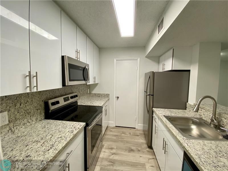 Totally renovated and spacious 2/2 apartment at Palm Aire Gardens. New wood floors and freshly painted. New bathroom and kitchen cabinets with new stainless steel appliances .Granite counter tops.  New washer and dryer inside the unit. Located at 3rd floor with vaulted ceilings and garden view. Available garage for an additional $100/month
