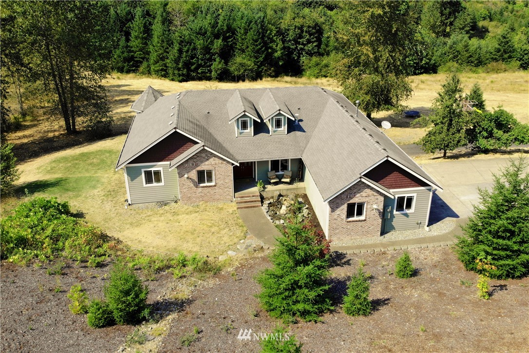 Incredible custom built home on 5 acres.This daylight basement home has Master on main w/ huge walk in closet,bath w/giant tiled shower&soaking tub. Amazing chef's kitchen w/granite counter tops, SS appliances & lg pantry. Huge office & craft room could be 5th/6th bedrooms.Potential for in-law suite w/ lower lvl 3/4 bath & 1 car garage in addition to 3 car garage above. Great territorial view w/ spectacular sunsets, quiet neighborhood, close to town, yet feels rural. Just 7 minutes to JBLM gate.