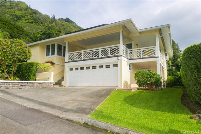 This majestic Manoa Valley home has Spectacular Views of the Mountains, City and Ocean. This split level home was extensively renovated from 2004 to 2018 with a newer Addition, wrap around covered lanais are great for entertaining, spacious living and dining rooms, French doors, Breakfast nook with lots of windows that brighten this home. The property features Stainless Steel appliances, Corian counters, 32 Panel PV System, Attic Fan, Split air conditioners, Ceiling fans, Luxury vinyl plank flooring, Slate Tile, Wool carpets, Custom Sunburst shutters, In-law suite with roll-in shower stall, laundry room, utility closet and tons of storage space. The spacious two car enclosed garage has lots of storage, driveway area and professionally landscaped yard with tropical plants and fruit trees.