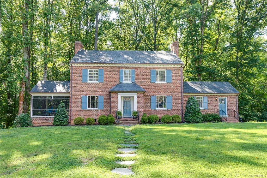 You don't want to miss seeing this lovely brick & slate colonial in Windsor Farms on St. David's Lane.  Situated on almost an acre, this 3 bedroom 2 1/2 bath home has many wonderful updates.  The front to back center foyer has 2 coat closets & arched doorways leading to the formal rooms.  The living room has a wood burning fireplace with granite surround, and there is a large window overlooking the very private back yard; a screened porch adjoins the living room.  The formal dining room leads to the completely renovated kitchen (2014); marble countertops, a subway tile backsplash, gas cooking, stainless steel appliances, and even new plumbing. There is a cozy family room with a fireplace and nice storage closets.  The second floor has 3 bedrooms, including a master bedroom with a walk-in closet & en-suite full bath.  The other 2 bedrooms have sliding double door closets.  Great storage with a walk-up attic, attached 1-car garage, large unfinished walk-out basement that is heated and cooled and has a fireplace.  Additional features include refinished floors, security system, irrigation, newer hot water heater & heat pumps, newer gutters, freshly painted inside and out.