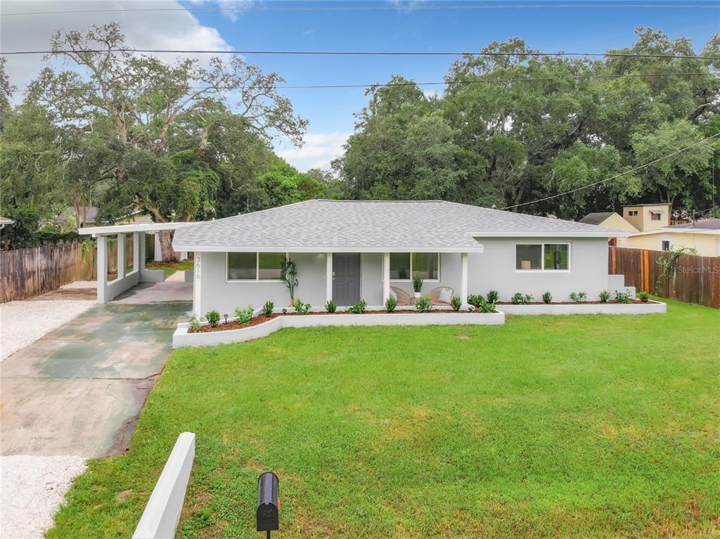New Construction Quality for Existing Home Pricing! Come see this completely remodeled 4 Bedroom, 2 Bathroom, 1 Car Carport Home in beautiful sunny Sarasota, Florida! This recently updated concrete block construction property is ready for you and everything is Brand New and Permitted in 2021! The modernized kitchen boasts sleek new quartz countertops, classic shaker kitchen cabinets, an oversized sink, and gorgeous new Stainless Steel Appliances. Ceramic tile floors throughout the home are complemented by the all new lighting and chic new paintjob. You can entertain in the open floorplan living room and enjoy a meal at the giant kitchen bar. Or relax in the master bedroom with new en-suite bathroom featuring a large walk in shower. Plenty of room for friends with all the guest bedrooms, and don't miss the completely redone guest bathroom with beautiful new ceramic tile surround. The added 4th bedroom makes a great den, library, or work from home space with it's own private entrance. Plenty of driveway space and parking under your own attached carport with separate entrance to the laundry room. The exterior of the home features new hurricane windows, with fresh stucco, a sharp new paint job, and a lovely new patio area & sitting area. This house has a ton of curb appeal too with the new landscaping that has been updated, pruned, and freshly mulched. (New Roof, AC, Electrical, Plumbing, Insulation, Windows, Stucco, Paint, Appliances, Flooring all work properly permitted  and completed 2021) With all these fantastic updates, this property is move-in ready… so schedule your showing today before it's gone!