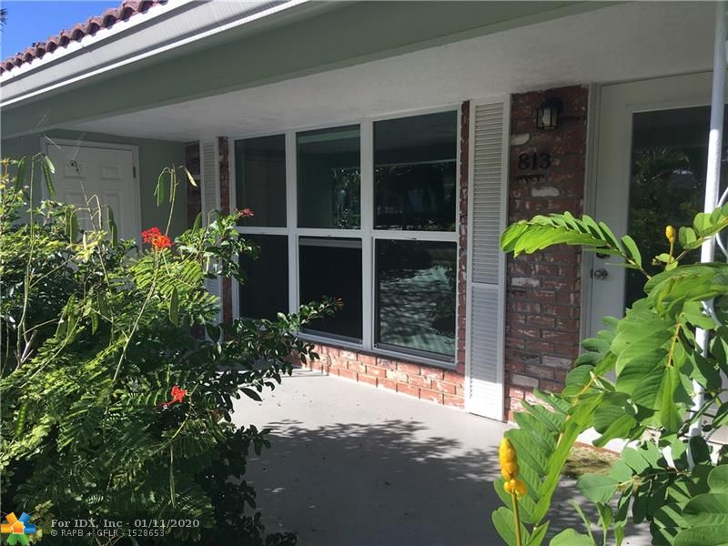 East of Federal only minutes to Beach! New impact windows and doors, new kitchen cabinets and granite counter tops, new a/c, hot water heater, good square footage, lots of storage and closets, tropical landscape, well water sprinkler system, fully fenced back yard, storage shed with electricity, over sized screened in patio with tile floor, located on quiet street in nice area with sidewalks.