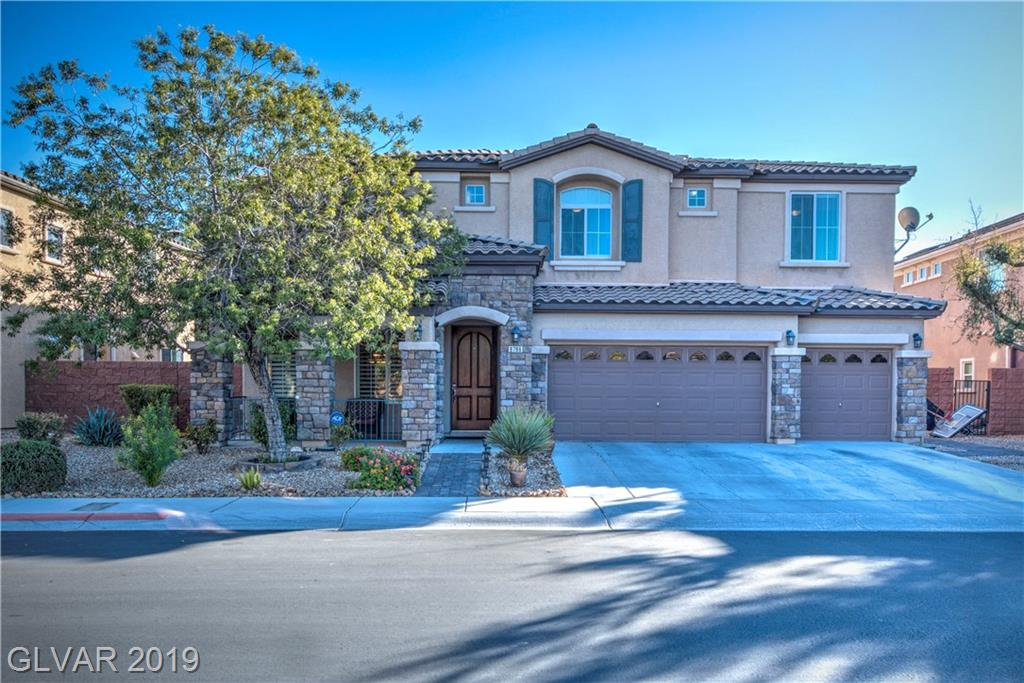 "Very well maintained, nicely upgraded Mountain's Edge gated home!  Featuring tile/dark laminate wood, shutters, new 2-tone paint, & ceiling fans t/o! Large kitchen opens to family room, w/tons of cabinet space (dark espresso), lrg island, SS appliances (new double ovens), & granite. Family room w/20"" ceilings, custom built-ins, & fp, Bed w/bath down, huge master +3 beds +huge loft w/balcony and wetbar up! Yard w/patio cover, pool/spa, & B-I BBQ!"