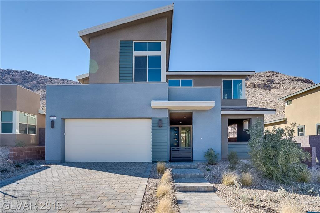 Tastefully upgraded-Modern, Open concept home located in the Cliffs Village of Summerlin South. Indoor/outdoor living at it's finest! Quartz countertops, designer cabinetry and flooring, stainless steel appliances, outdoor lounge, and stacking doors. POOL SIZE LOT! Come see today!